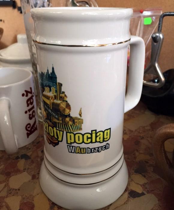 Image: A mug featuring an image of the Nazi treasure train