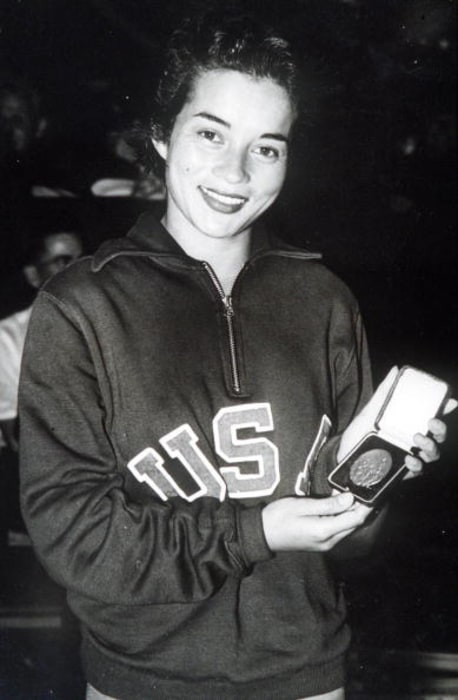 1948 Olympic Games. London, England. Springboard Diving. USA's Vicky Draves with her gold medal. She also won a gold medal in the Highboard event.