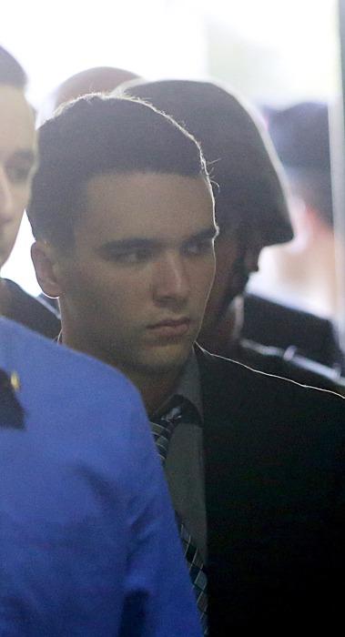 Image: U.S. Marine Lance Corporal Joseph Scott Pemberton is escorted into court