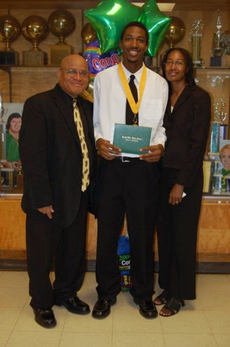 Image: Officer Liquori Tate with his parents after graduation