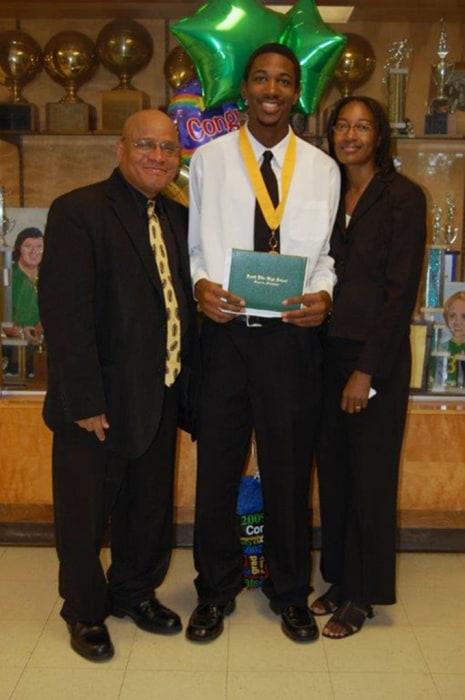 Image: Officer Liquori Tate with his parents after graduation