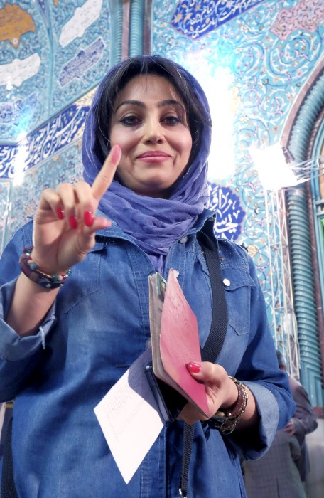 Image: Iranian woman shows her ink-stained finger after voting