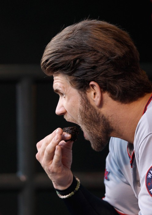 Image: Bryce Harper of the Washington Nationals puts chewing tobacco in his mouth