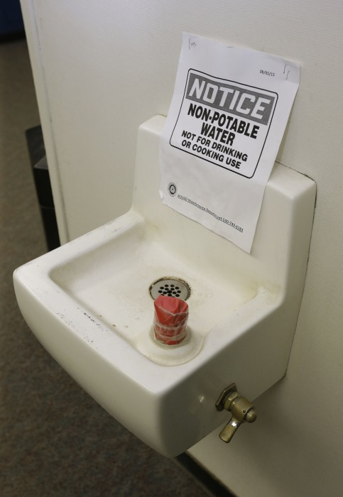 Image: Tape covers the spout and a sign warns students not to use this water fountain
