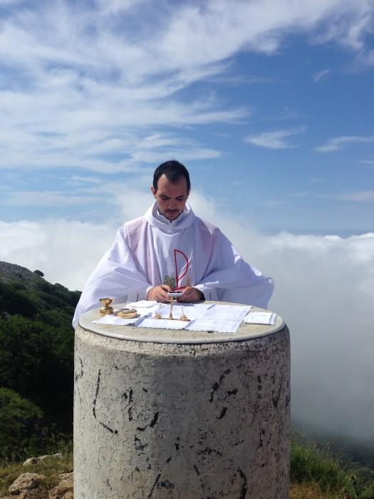 Father Sergio Munoz Fita celebrates mass at the top of Mt. Ernio in Spain.