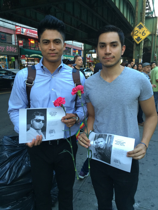 Marchers hold photos of Orlando Shooting victims.