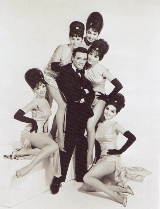 "In this mid-1960s publicity photo, singer Jimmy ""Jay"" Borges poses with, from left to right, Joanna Pang, Arlene Wing, Kako Tani, Sisko Borges (Borges' then-wife), and Cynthia Fong."