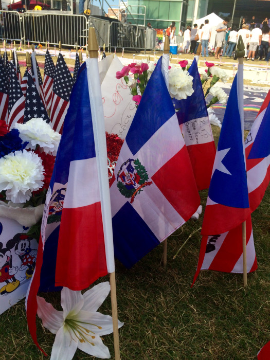 Flags at a vigil in Orlando for shooting victims.