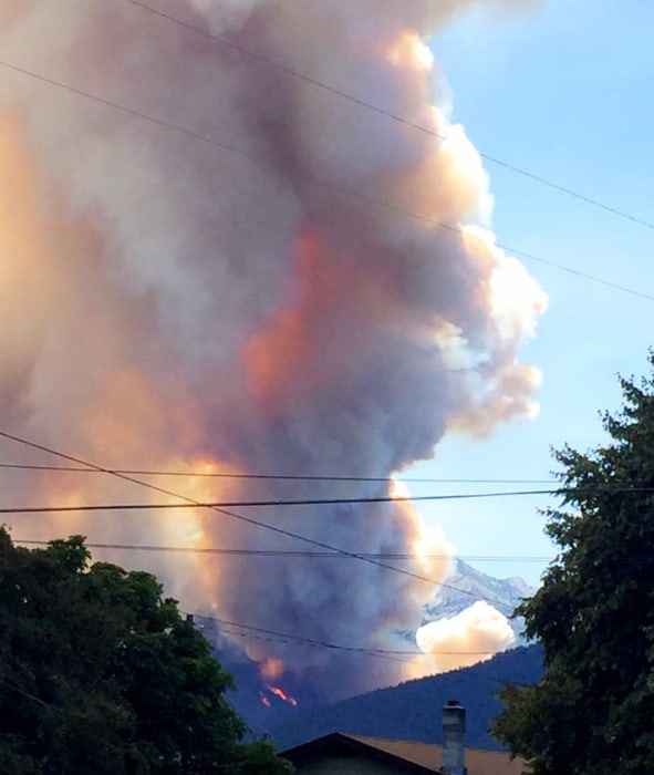 Image: Flames and smoke rise from the roaring Lion Wildfire