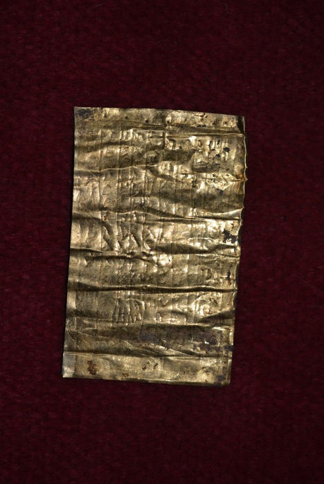 """Image: A gold-inscribed """"curse tablet"""""""