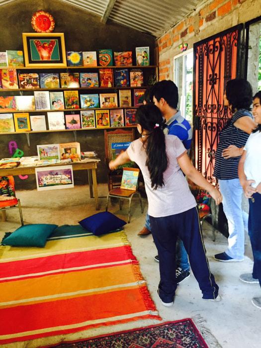 Students exploring the Library of Dreams in San Jacinto, El Salvador.