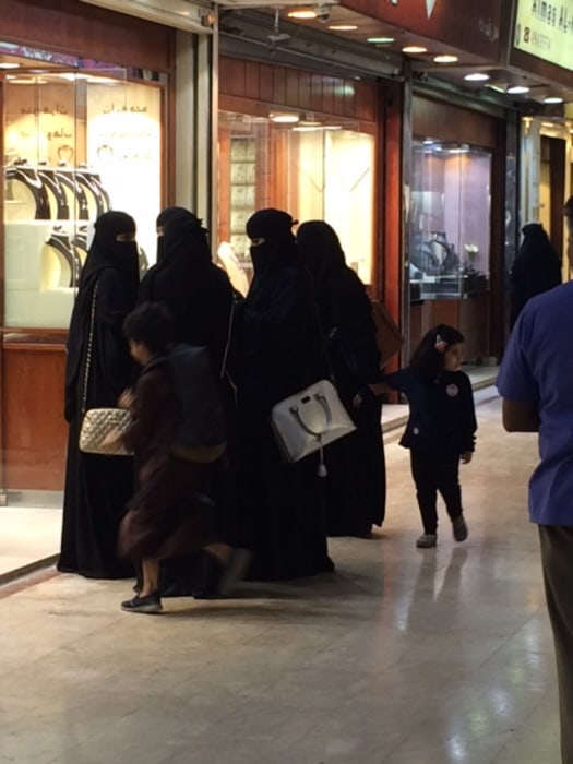 Image: Women walk in Riyadh's Kuwaiti Souk