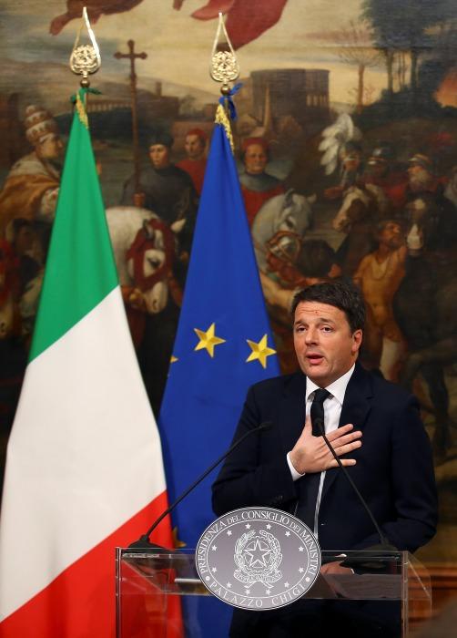 IMAGE: Italian Prime Minister Matteo Renzi resigns