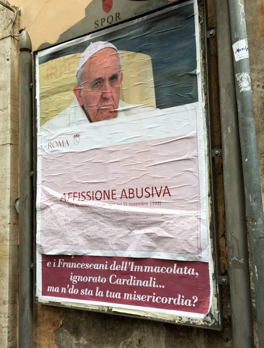 "Image: A paper sheet with writing in Italian reading ""Illigal Posting"" covers an anti-Pope Francis poster in central Rome, Italy, Feb. 4, 2017."