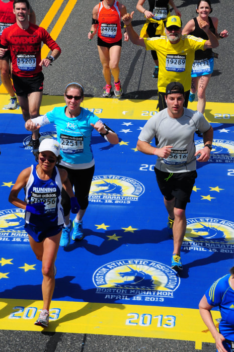 Chau Smith running at the start of the Boston Marathon in 2013