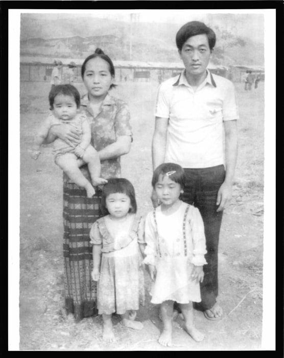 A young Kristy Yang and her family in a refugee camp in Thailand