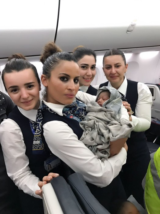 Image: Cabin crew and baby