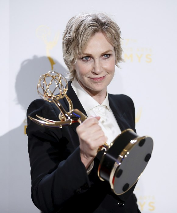Image: Jane Lynch poses with her Emmy award for outstanding host for a reality or reality-competition