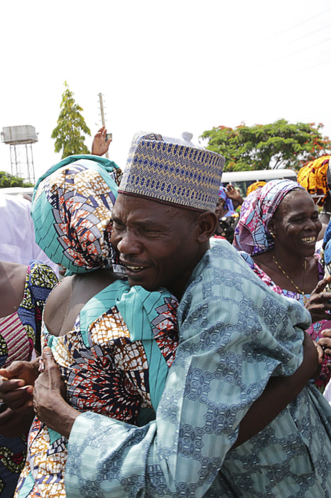 Image: A family is reunited with the released Chibok girls in Abuja