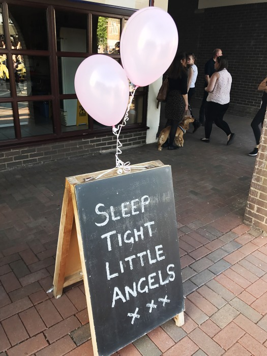 """Image: A sign at the vigil in Tarleton, England reads """"Sleep tight little Angels"""""""