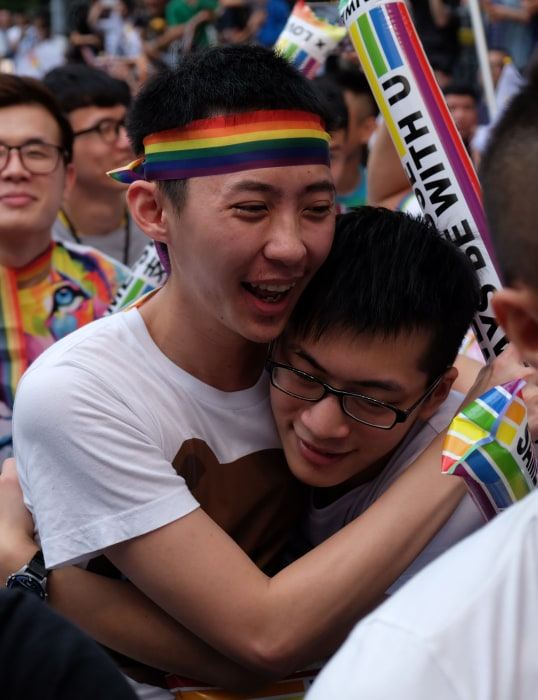 Image: Crowds cheered, hugged and wept as a Taiwan court ruled in favour of same-sex unions.