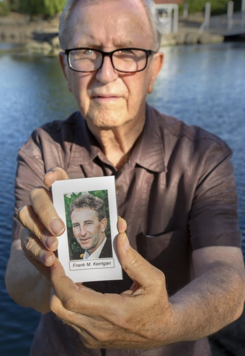 Image:  Frank Kerrigan holds onto a a funeral card for his son Frank