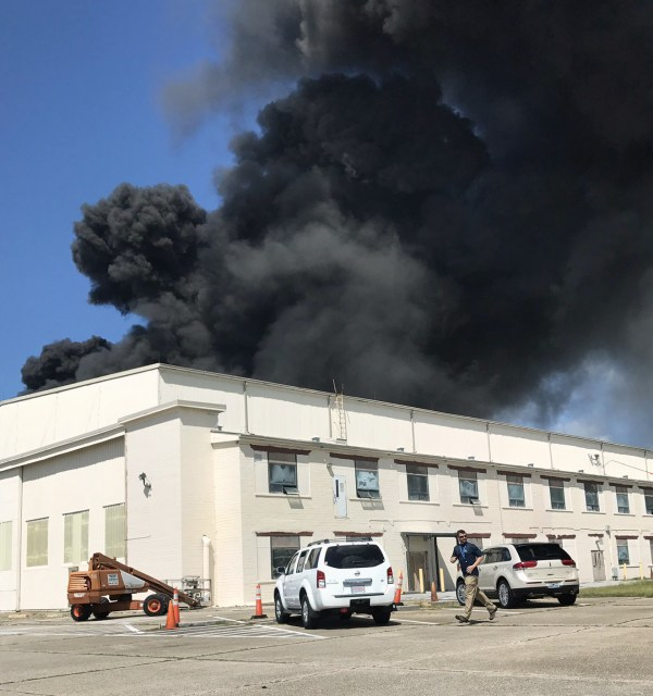 Image: Heavy smoke billows from a building at Eglin Air Force Base