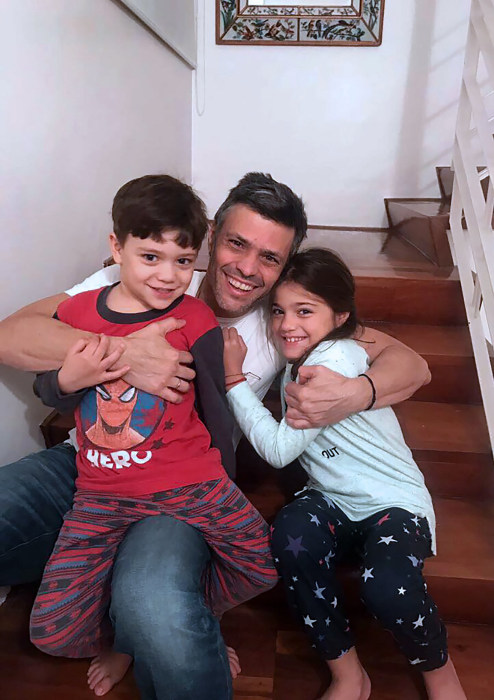 Image: Venezuelan opposition leader Leopoldo Lopez hugging with his children at his house in Caracas