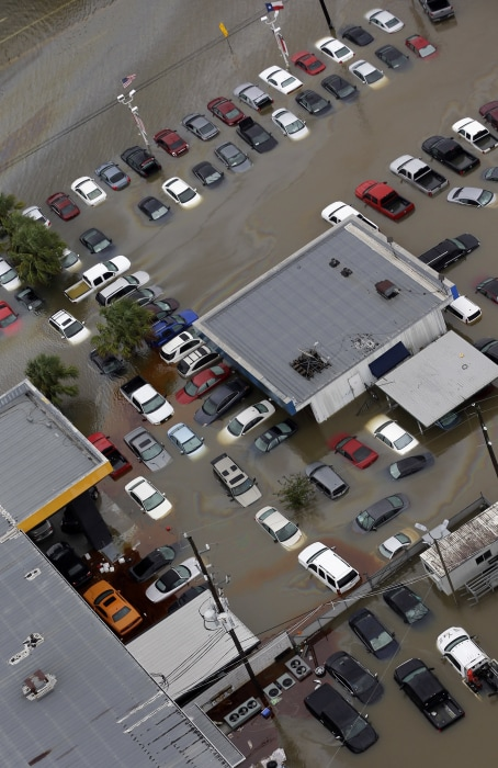 Image: Cars and businesses are flooded near the Addicks Reservoir