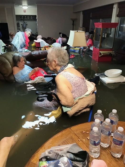 Image: Residents of the La Vita Bella nursing home in Dickinson, Texas, sit in waist-deep flood waters