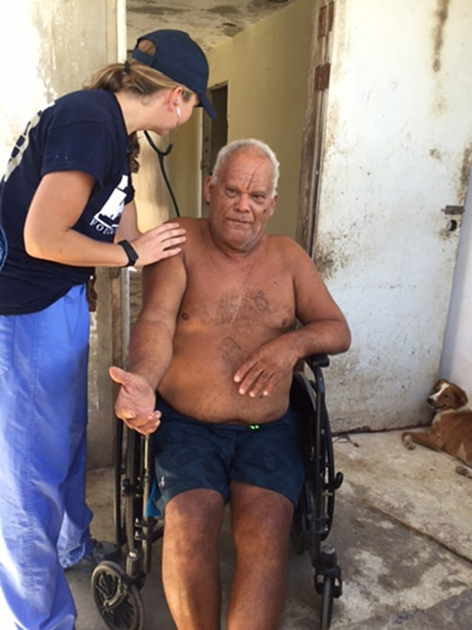 Image: Nicole Merrill, a Nurse practitioner From Portland Maine, checks on Isabelino Aponte Rivera, 70, resident of Loiza, Puerto Rico.