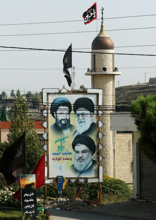 Image: Portraits of Musa al-Sadr, Ali Khamenei and Hasan Nasrallah