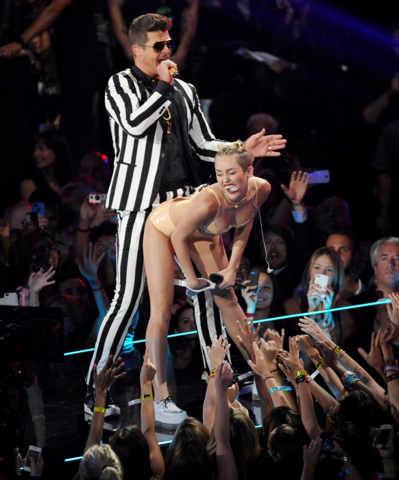 Robin Thicke, left, and Miley Cyrus perform at the MTV Video Music Awards on Sunday, Aug. 25, 2013, at the Barclays Center in the Brooklyn borough of ...