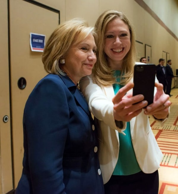 This June 14, 2013 photo released by Barbara Kinney shows former Secretary of State Hillary Rodham Clinton, left, posing with her daughter Chelsea at ...