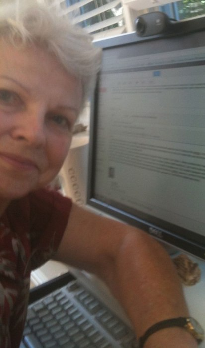Michal Poe at her computer.