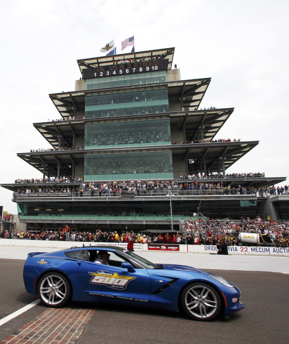A 2014 Chevrolet Corvette Stingray passes by the grandstands as it paces the 97th running of the Indianapolis 500 at the Indianapolis Motor Speedway in Indianapolis, Ind., May 26, 2013.
