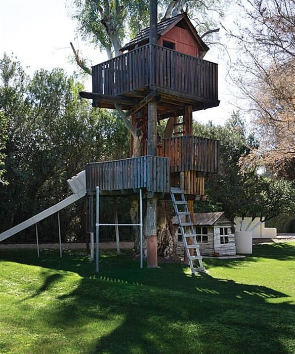 The previous owners built a three-story treehouse on the grounds of this Phoenix property.