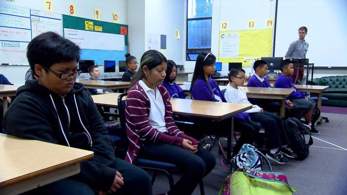 Image: Students at Visitacion Valley School in San Francisco meditate