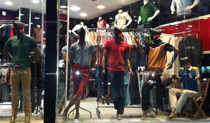 Image: Mannequins with their faces covered are displayed in a shop window in central Mosul