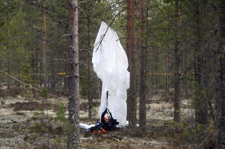 Image: A parachute hangs from a tree close to the wreckage of experimental aircraft Comp Air 8 next to Jamijarvi Airfield, southwest Finland