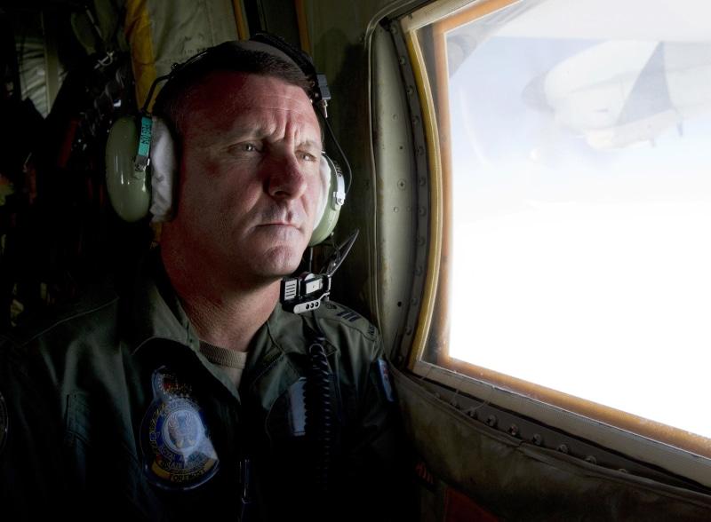 Image: Royal Australian Air Force loadmaster Flight Sergeant John Mancey scans the ocean