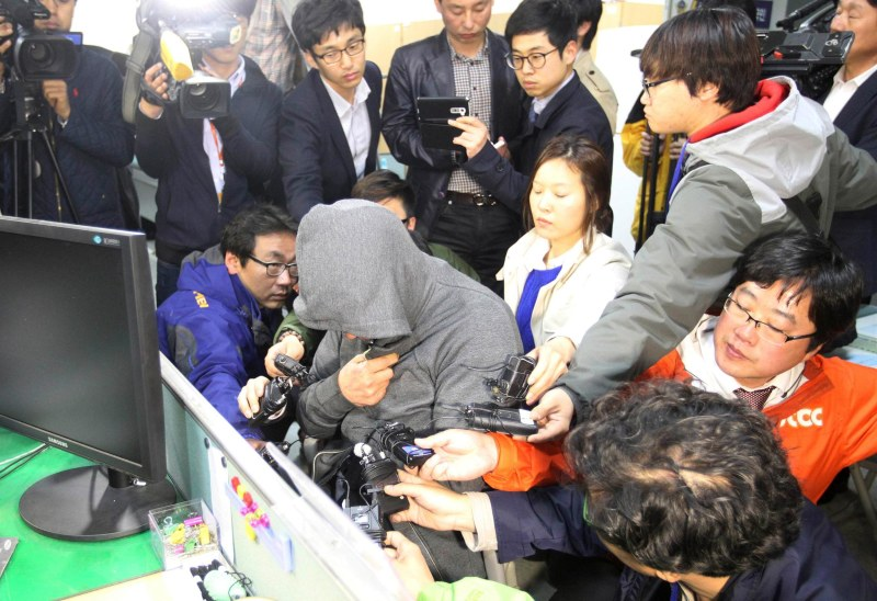 Image: The captain of the South Korean ferry Sewol, which sank at sea off Jindo, is investigated at Mokpo police station