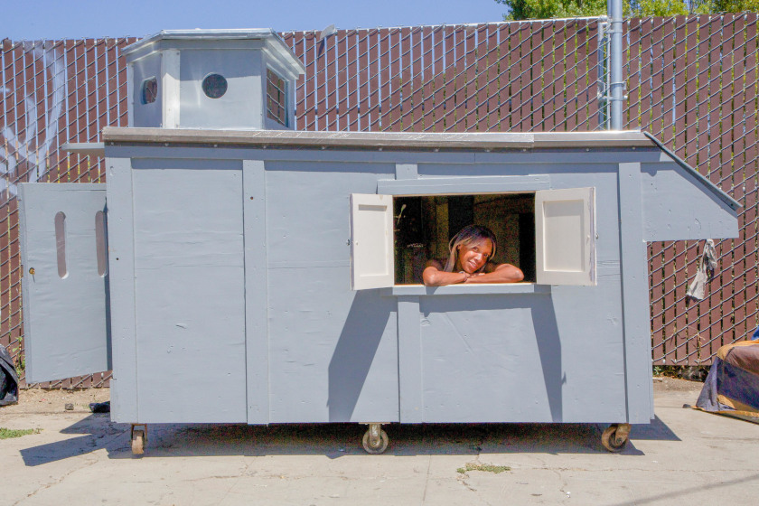 A woman is seen in a shelter built by California artist Gregory Kloen.