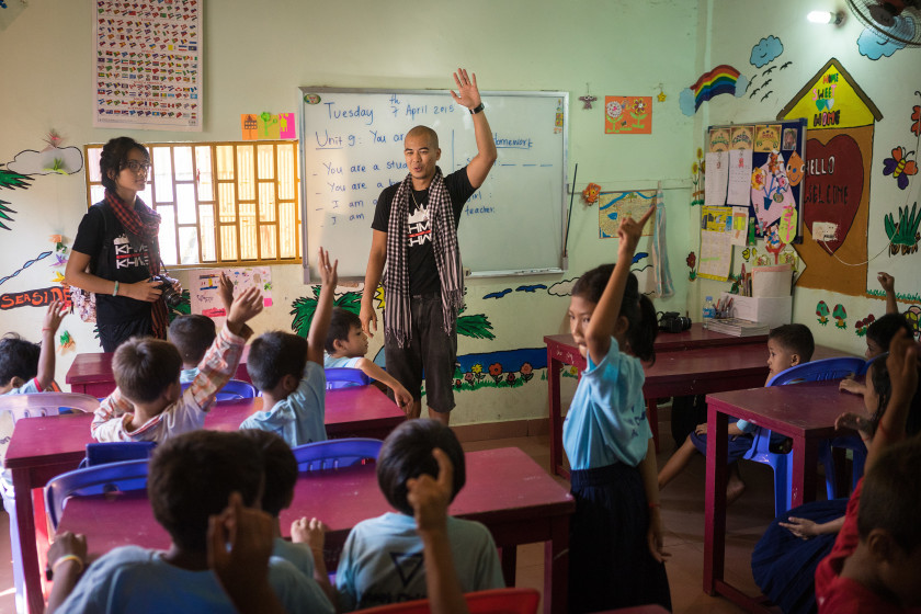 Image:  Ron Ung teaches a group of kids how to use a digital camera in one of the school supported by YMCA located in a poor neighborhood of Phnom Penh.