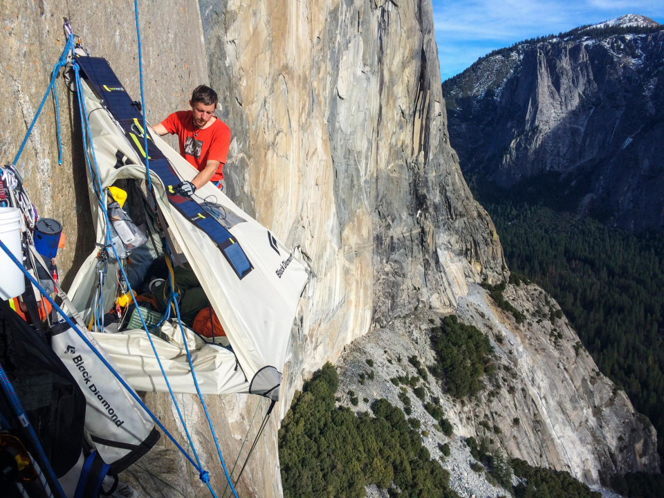 Tommy Caldwell adjusts his tent while hanging off of Dawn Wall on the El Capitan mountain in Californiau0027s Yosemite National Park. & Hardest Rock Climb ever done!
