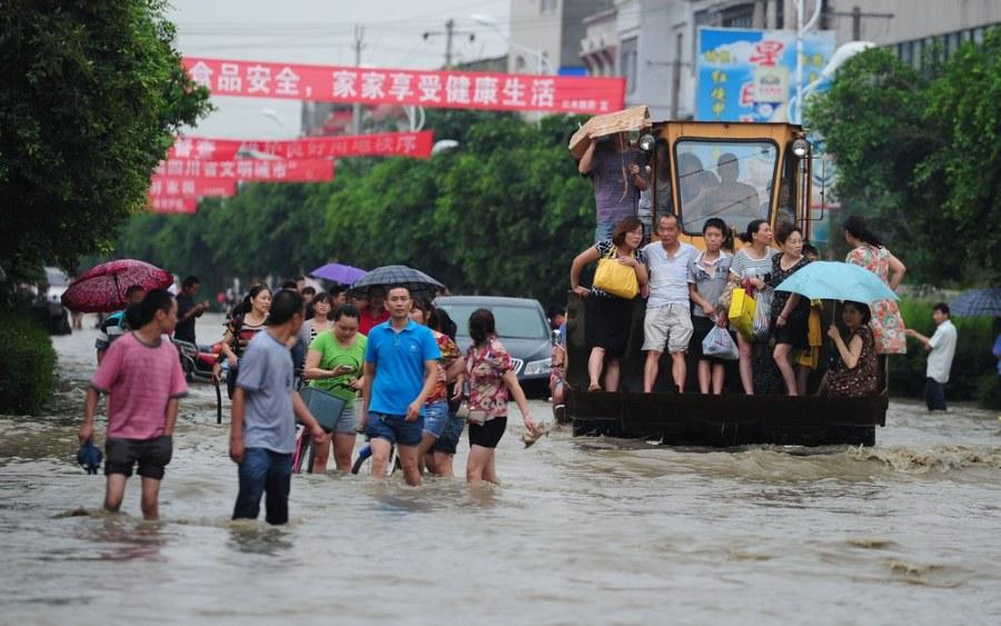China floods trigger landslide, bridge collapse; dozens remain missing