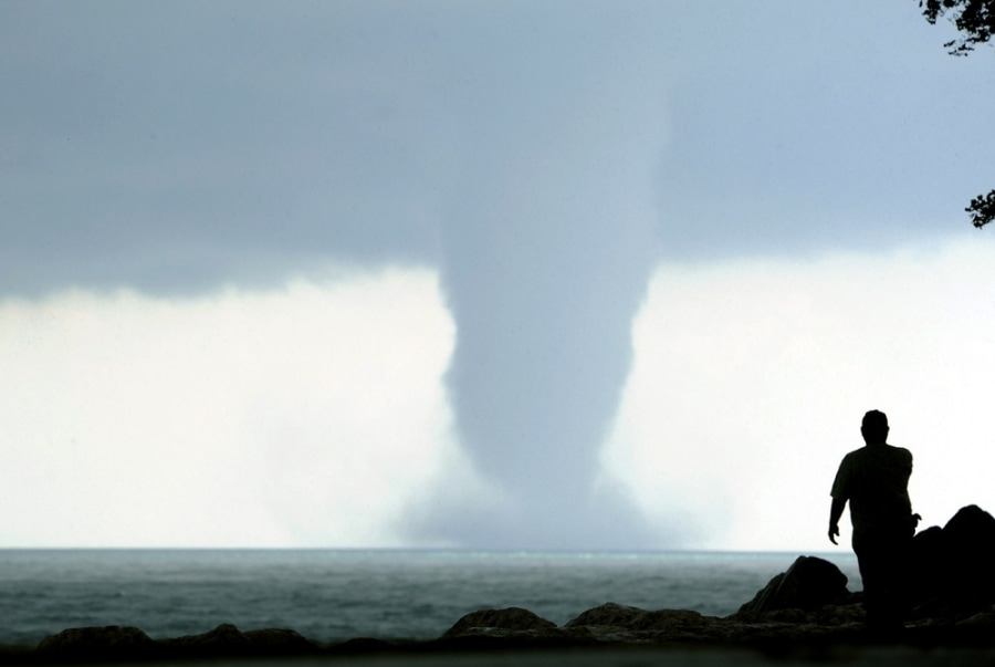 Dueling water spouts form over Lake Michigan
