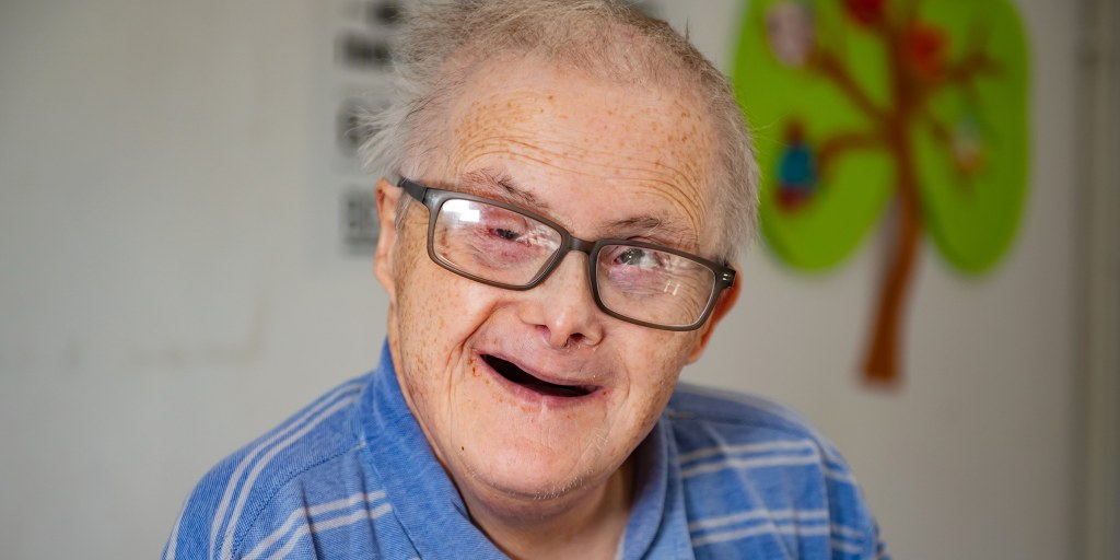 Man with Down syndrome defies odds and celebrates 77th birthday
