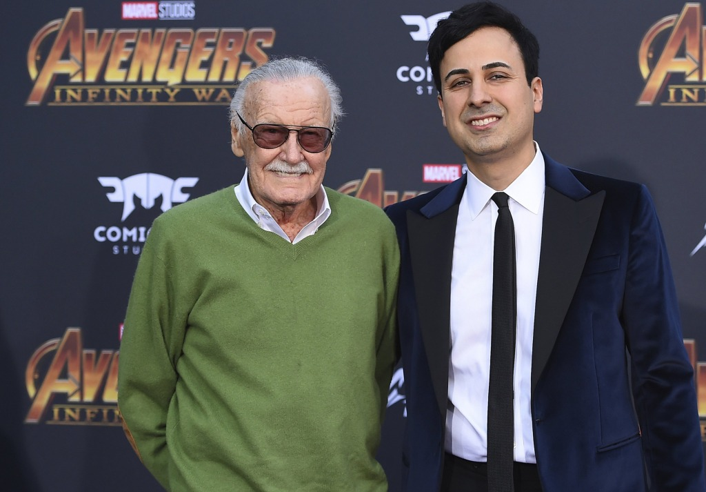 Stan Lee stands beside Keya Morgan