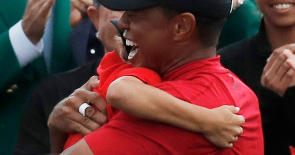 tiger woods embraces his kids after his 2019 masters win in augusta